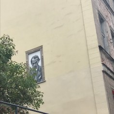 Representation of the writer Bruno Schulz on a wall in Wroclaw