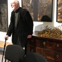 A. Strumillo in his studio, mistletoe in the background