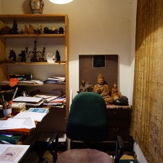 Buddha statues, front view, and the desk of the artists