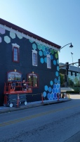 Mural on House in central Fayetteville by Marina Zumi (Argentina) within the Green Candy Art Action Project
