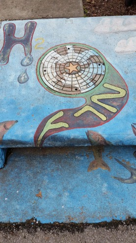 This is part of the environment, drainage system art, Fayetteville, AR, USA