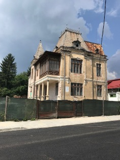 Amazing blend of neo-classicism (the pillars of the porch), French historicism (the roof), and Oriental patterns (the wood balcony); the house is located on Republicii Boulevard in Câmp