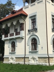Detail of the neo-Romanian style of house, notice the vernacular influences