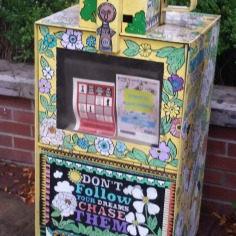 `Don`t follow your dreams, chase them`, street art on a collecting box, Fayetteville, Arkansas