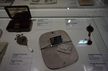 Envelope Bag with a mirror (1920), Make-up case (1930), Polished Hand Mirror (1890)