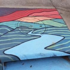 Manhole, water drainage system, street art Fayetteville