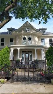 stone base and iron fence, house on washington willow street, fayetteville, nw arkansas