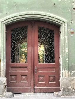 Metal door handle and metal decoration of house`s entrace in Sibiu, Romania
