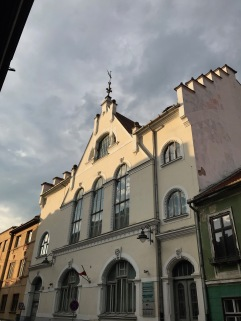 Weather vane, flagpole and street light on facade of the Museum of Contemporary Art, Sibiu, Romania