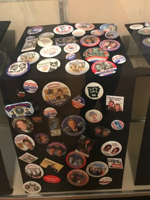 Collection of pins representing Bill Clinton and presidential campaign themes