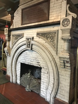 Crescent Hotel hall, Art Nouveau style fire guard by a magnificent Art Nouveau fireplace