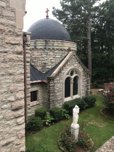 In the center, the statue of Saint Joseph holding the baby Jesus and in the background the initial chapel built in 1904 by Richard C. Kerens in the memory of his late mother, named Elizabeth; the chapel is built to resemble Hagia Sophia of Istabul