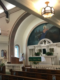 Sanctuary has the original marble altar of the rotunda chapel, the Tabernacle in the center, and the Crucifix above made of serpentine marble in a Botonee design, the mural `The Agony in the Garden`