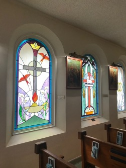 Some of the stained glass designed by Liz Ryan and created by Jim Fliss, in the 1990s; all windows original to the church were rose-red, an allusion to St. Elizabeth`s miracle