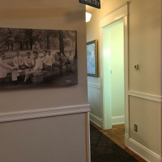 The ground floor has old pictures on display, depicting the campus life