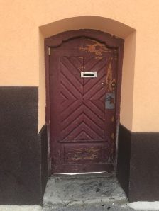 Door with mail slot in Rasnov town centre