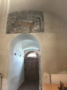 Mural detail above the original entrance in the old church
